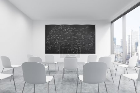 A classroom or presentation room in a modern university or fancy office. White chairs, a black chalkboard with math formulas on the wall and panoramic New York view. 3D rendering.