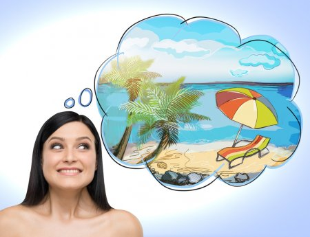 A portrait of astonishing brunette woman who dreams about summer vacation on the beach. A nice summer place is drawn in the thought bubble. Light blue background.