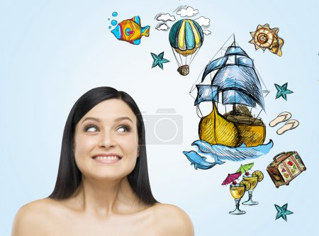 A portrait of astonishing brunette woman who dreams about summer vacation. Nice summer sketches are drawn on the light blue background.