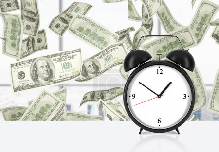 An alarm clock is on the table. Falling dollar notes on background. The concept of 'time is money' and a time management.
