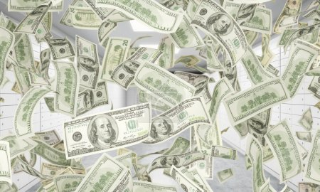 Dollar notes are falling down from ceiling. A bright space with safe deposit boxes are on the background. 3D rendering.