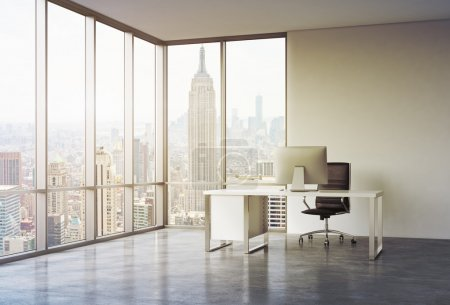 A workplace in a modern corner panoramic office with sunset New York view. A white desk with a modern computer and black leather chair. A concept of consulting services. 3D rendering. Toned image.