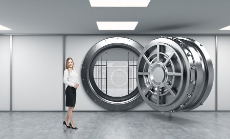 smiling young lady standing in front of a big unlocked round met