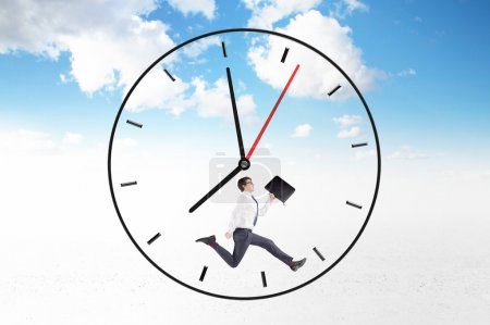 Young businessman with a folder in hand running around clock face, hands showing 8 o'clock.