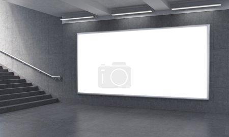 Photo pour Panneau d'affichage dans le sous-sol, escaliers vers la gauche. Des murs gris. Concept de publicité souterraine. rendu 3D - image libre de droit