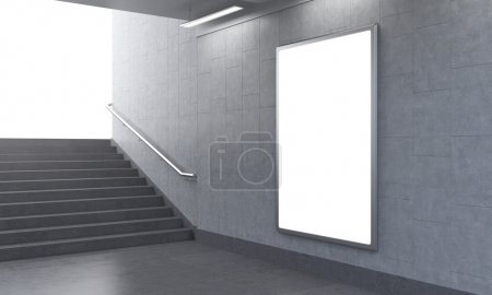 One vertical billboard in the underground, stairs up to the left, light seen.