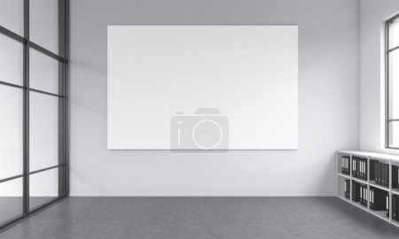 Photo pour Office space with no furniture except floor shelves for folders and a blank white poster on the white wall, window to the right. Concept of a new office. 3D rendering. - image libre de droit