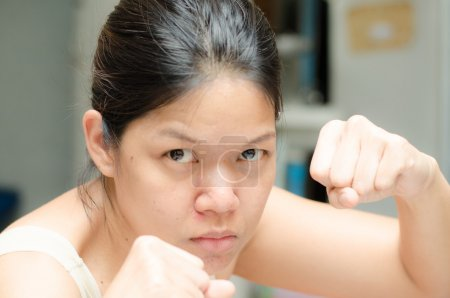 Asian woman ready to fight guading with empty hand