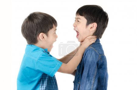 Little sibling boy fighting on white background