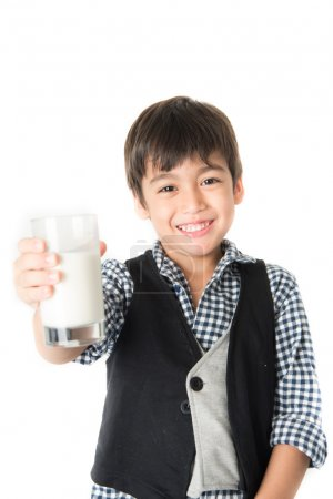 Photo for Little boy drinking milk on white background - Royalty Free Image