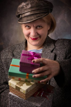 The woman with a gift box. Festive and joyful mood...