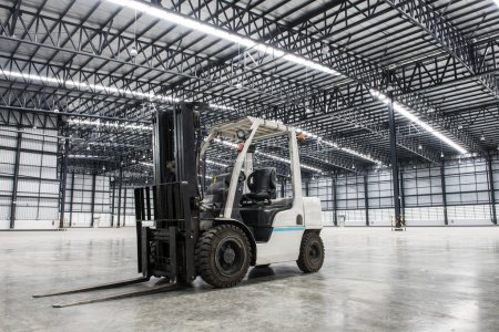Forklift loader in large modern storehouse