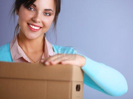 Portrait of pretty woman holding a box