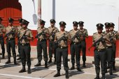 Rows of Policemen with Machine Guns in Peru