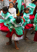 Costumed Girls Dance in Parade in Peru