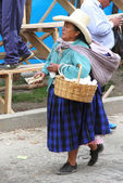 Peruvian Woman Selling Peanuts from Basket