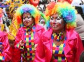 Two Women in Colorful Clown Costumes in Carnival Parade