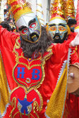 Red Masked Figures in Carnival Parade