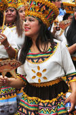 Smiling Young Woman in Traditional Costume Marches in Parade