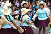 Peruvian Women in Traditional Dress Dance in Parade