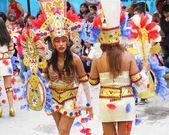 Young Women in Colorful Costumes in Carnival Parade