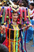 Woman in Multi-colored Costume in Carnival Parade