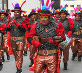 Red Costumed Band Plays in Carnival Parade
