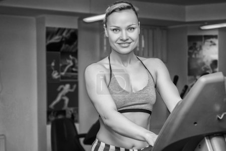 Girl on treadmill.Black and white...