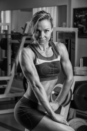 Woman shows her muscles