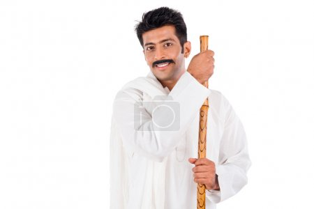 Portrait of a man holding a wooden staff