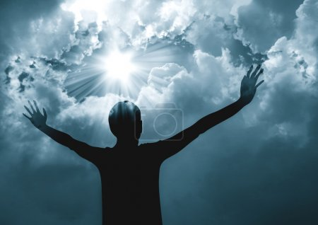 Photo for Silhouette of a woman praising to God - Royalty Free Image