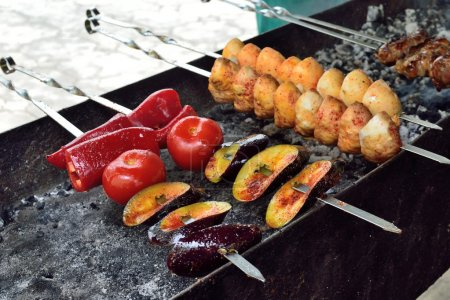 skewers of meat and vegetables on a brazier