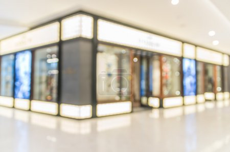 Abstract blurred photo with people in department store bokeh