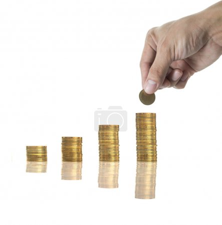 Hand holding and adding a golden coin on the stacks of golden coins with seed on white background, business investment concept