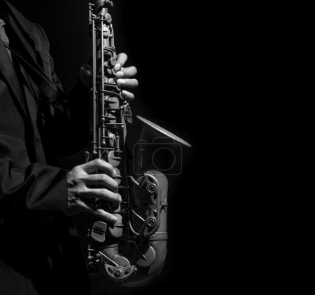 Closeup saxophone in player action on a dark background, black and white tone