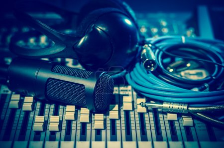 Photo for Closeup of microphone with headphones on mixer, music instruments concept - Royalty Free Image