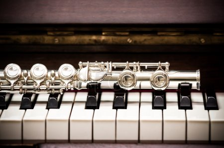 Photo for Closeup Flute on the keyboard of piano, musical instrument, vintage tone - Royalty Free Image