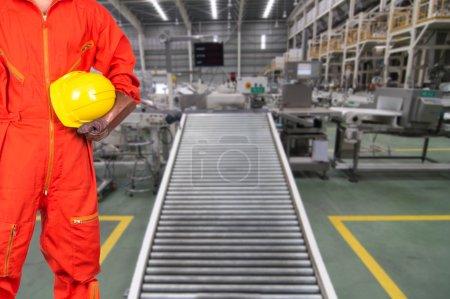 Asian engineer worker holding hardhat