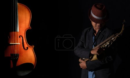 Saxophone player and Violin