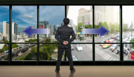 Businessman standing in doubt