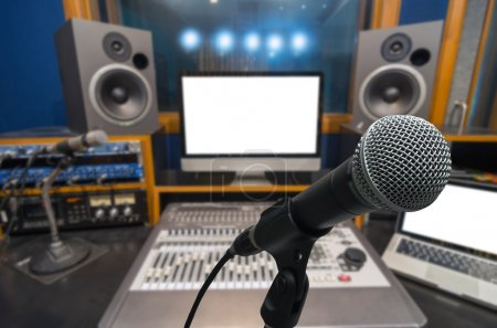 Photo for Microphone over the Abstract blurred photo of music studio recording room background, musical concept - Royalty Free Image