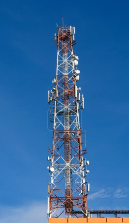 Telecommunications tower, radio or mobile phone on blue sky background