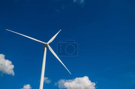 Closeup Wind turbine power generator on blue sky