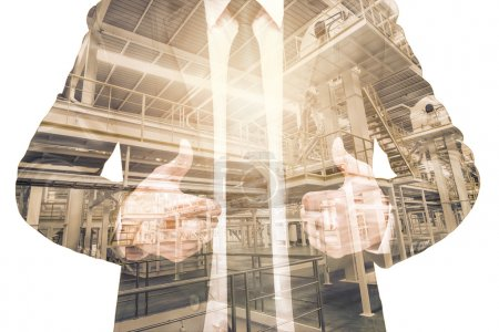 Double exposure of businessman with Industrial equipment Factory