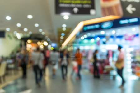 Abstract blurred photo with people in department store bokeh background