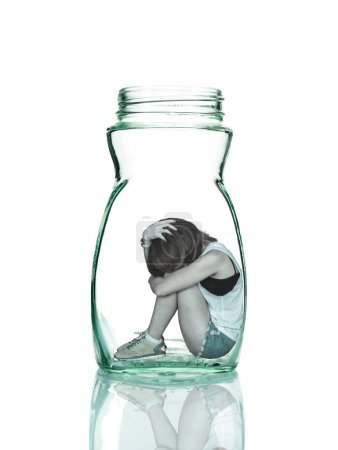 Photo for Sad woman sitting alone in a jar - Royalty Free Image