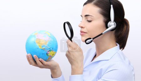 Photo for Concept search, customer service operator woman with headset, globe and magnifying glass - Royalty Free Image