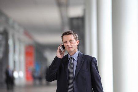 Photo for Businessman talking on the phone during a business travel - Royalty Free Image