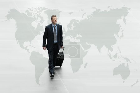 business man walking on the world map, international travel conc