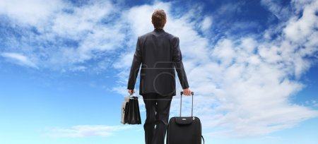Photo for Business man travel with trolley walking to the sky - Royalty Free Image